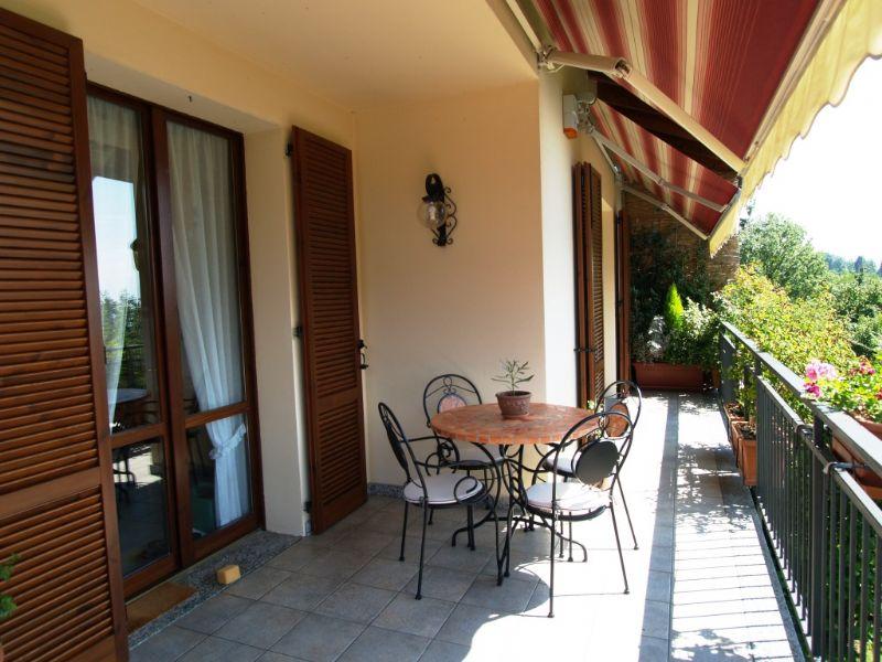 Casa bifamiliare con giardino e garage Vignone